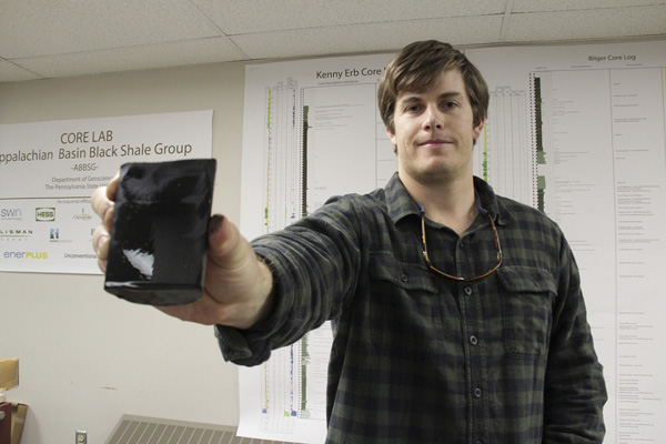 Master's student in Penn State's Department of Geoscience Dan Kohl with part of a Marcellus Shale core.