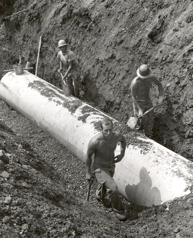 Alcosan workmen install a sewer line along Turtle Creek on the Monongahela River in 1957.