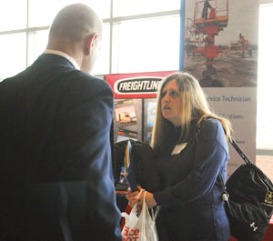 Veteran Barbara Weiblinger talks with a company representative at the 2012 Heroes to Hires job fair.