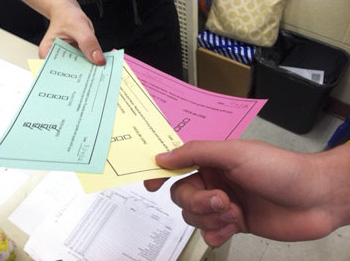 Green-, yellow-, and red-colored slips that let students know their status in the Promise Ready Corps.