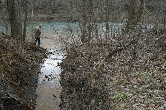 Sandy Liebhold checks water quality as it drains into Dunkard Creek in Green County, Pa.