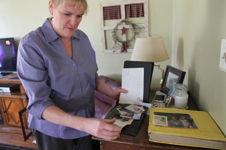 Norma Carpenter holds a photo of her mother, Mary Little