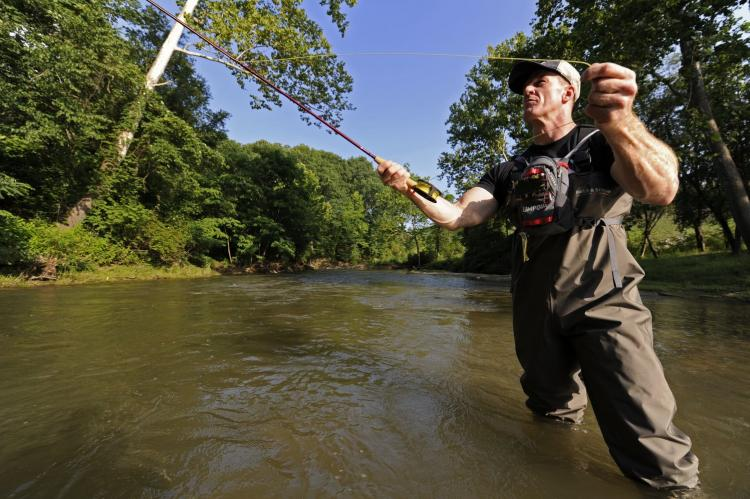 Snyder casts his line in Pine Creek in Cheswick, Pa.