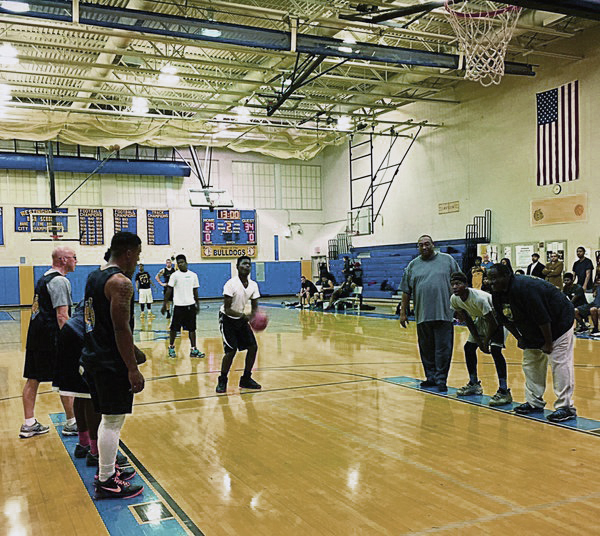 Students from Westinghouse Academy in Homewood faced off against Pittsburgh police at a Dec. 3 basketball game. (Photo courtesy of the Pittsburgh Bureau of Police)