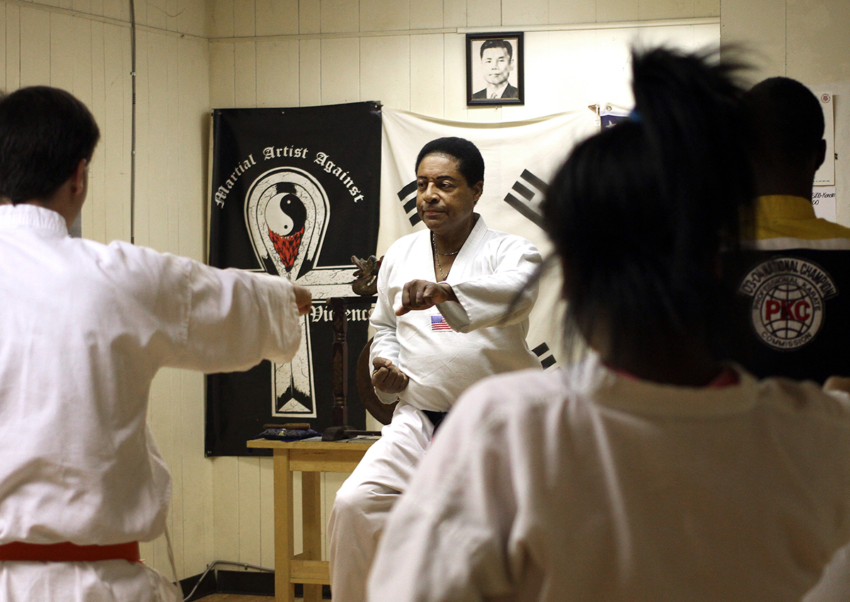 Grand Master Jacquet Bazemore leads a class at Martial Artists Against Street Violence, or MAASV, on Frankstown Avenue in Pittsburgh. The academy aims to teach martial arts as an alternative to violence in the community. (Photo by Ryan Loew/PublicSource)