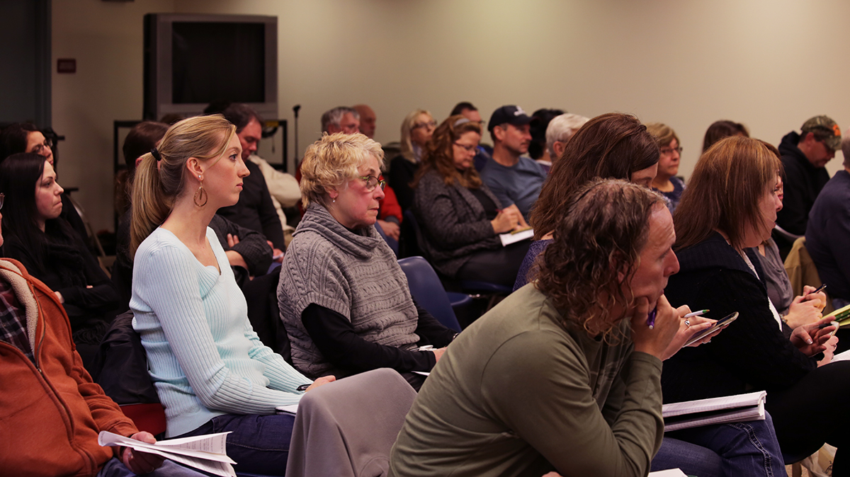 Residents of Penn Township listen to testimony at a zoning board hearing on Jan. 14 for one of Apex's proposed well pads. If the zoning board approves the permit, it will be only the second permit granted in Penn Township for fracking. (Photo by Natasha Khan/PublicSource)