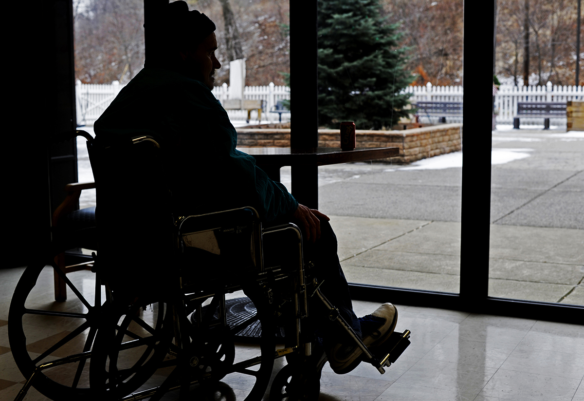 A resident sits in a common area of the Kane Regional Center in Glen Hazel in January 2015. PublicSource reported on the use of overtime at the nursing homes last year. (Photo by Connor Mulvaney/PublicSource)