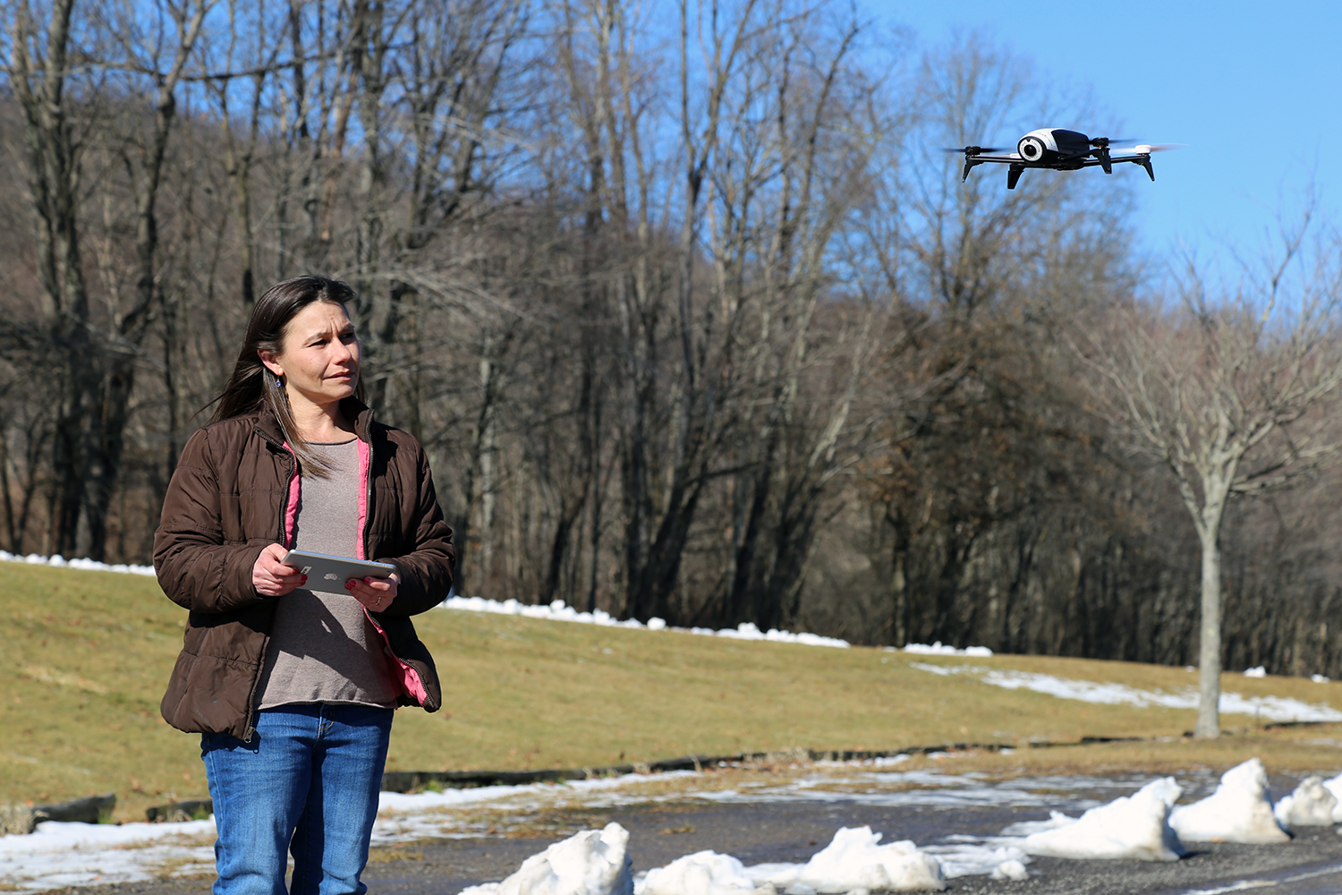 Kendall Early, of Wexford, keeps her Parrot BeBop 2 hovering just above eye level at Bush Creek Park in Beaver County. (Photo by Elizabeth Lepro/PublicSource)