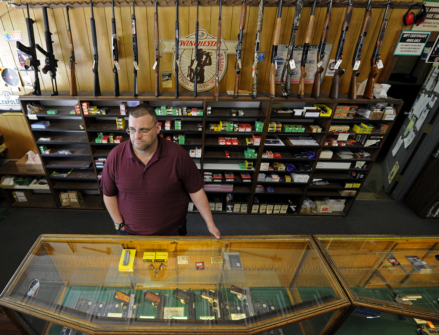 Keith Savage, manager of Braverman Arms in Wilkinsburg, said he does not believe the state should charge for background checks. (Photo by Connor Mulvaney / PublicSource)