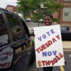 voluteer in Wilkinsburg asking passersby to register to vote