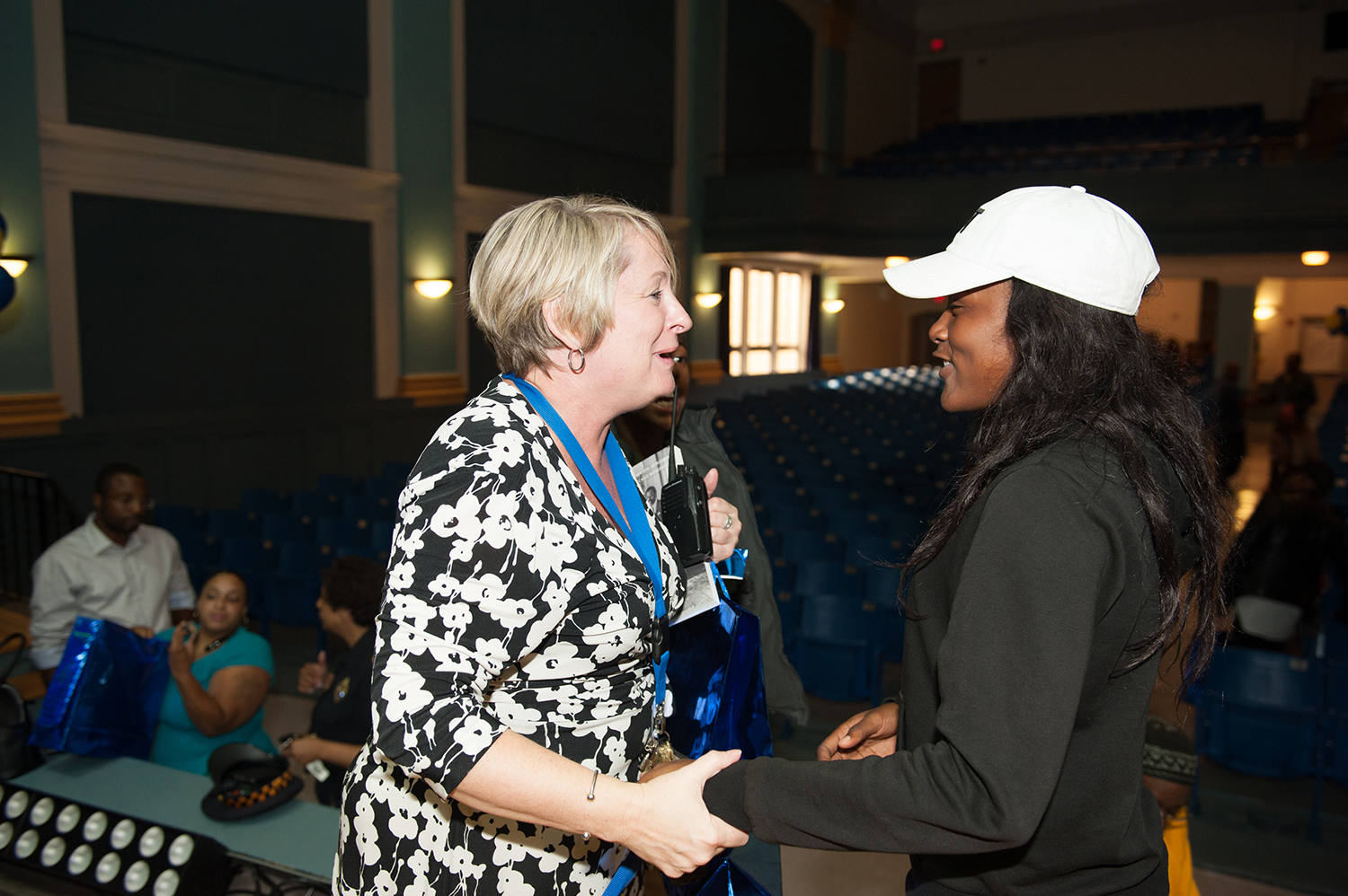LouAnn Zwieryzniski, principal of Westinghouse Academy, tells D-Ama Taylor how much she enjoyed hearing her recite her spoken-word piece. (Photo by Sarah Collins/PublicSource)