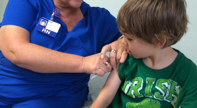 Child receives a shot