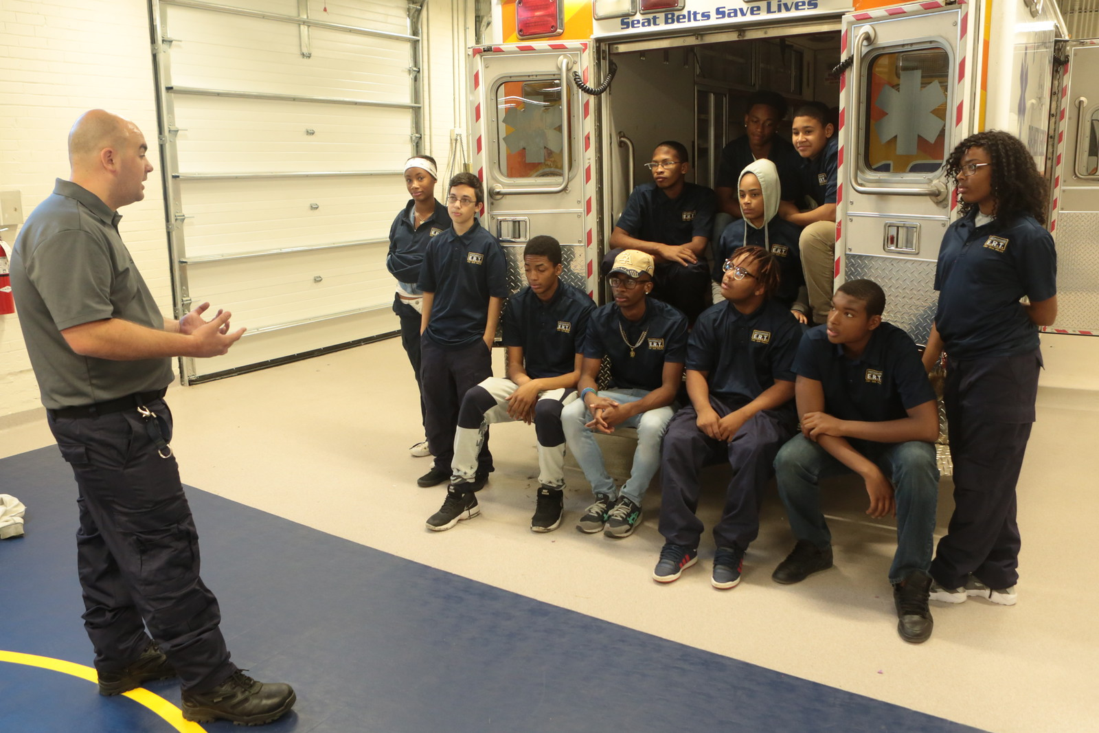 Students in the Emergency Response Technology program listen to the instructor at Pittsburgh's Westinghouse Academy. (Photo by Brian Cook/PublicSource)