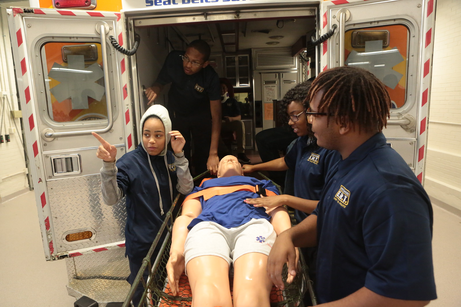 Students enrolled in the Emergency Response Technology program go through an EMT simulation session at Pittsburgh's Westinghouse Academy. (Photo by Brian Cook/PublicSource)