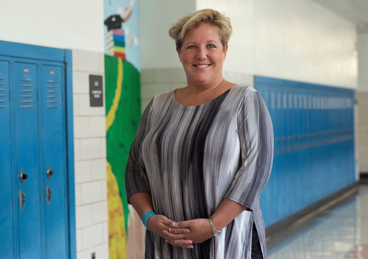 Tara Reis graduated from Woodland Hills High School. Now she serves as the president of the school board. (Photo by Martha Rial/PublicSource)