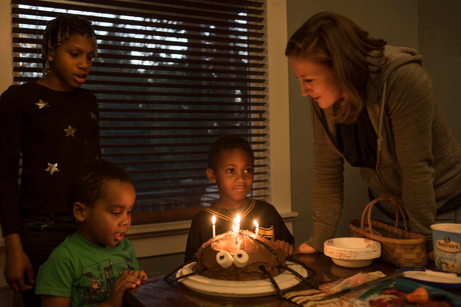 Carria, 5-year-old Darian and their mother Christi Rooke (right) sing happy birthday to Jeremiah (center) who turned 6 this month. (Photo by Martha Rial/PublicSource)