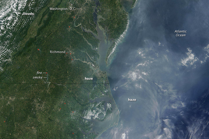The Moderate Resolution Imaging Spectroradiometer (MODIS) on NASA's Terra satellite captured this image of haze in the eastern United States on July 26, 2005. Easier to see over the ocean, haze hangs over the Mid-Atlantic region. Fires are marked with red dots. (Photo courtesy of NASA)