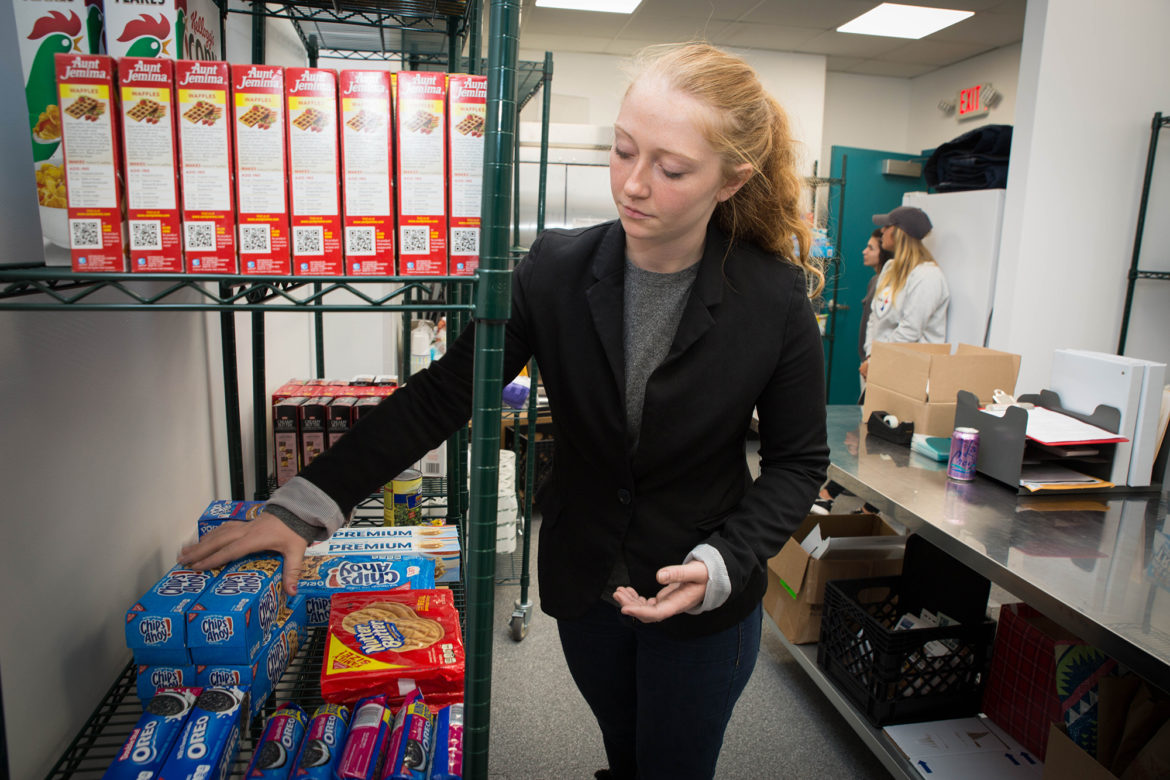 Student Chantelle Bellavance, 25, visits the food pantry at the South Campus of the Community College of Allegheny County once a month to supplement the food options for her and her 7-month-old daughter. (Photo by Njaimeh Njie/PublicSource)