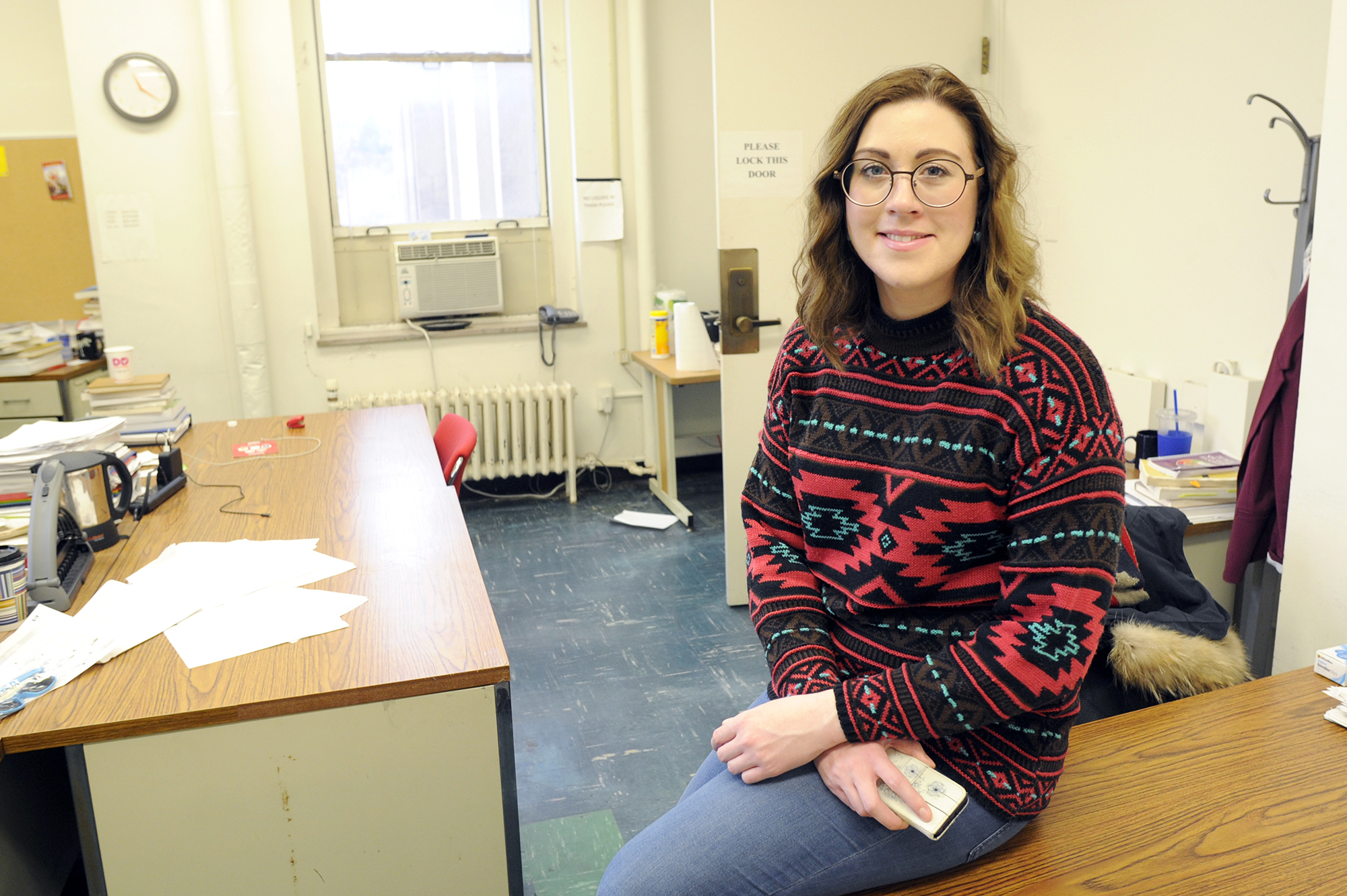 Once Andrea Hanna pays her monthly bills, she has about $150 left to spend on food. She finds food and toiletries at the Pitt Pantry. (Photo by Connor Mulvaney/PublicSource)