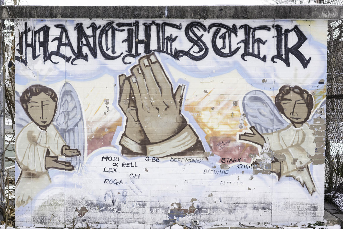 A mural in the Manchester neighborhood of Pittsburgh, adjacent to the basketball court where Scott Walker fatally shot Randy Hawkins in 1994. Walker is serving a sentence of life without parole, but his prison time could eventually be affected by a recent Supreme Court ruling. (Photo by Aaron Warnick/PublicSource)