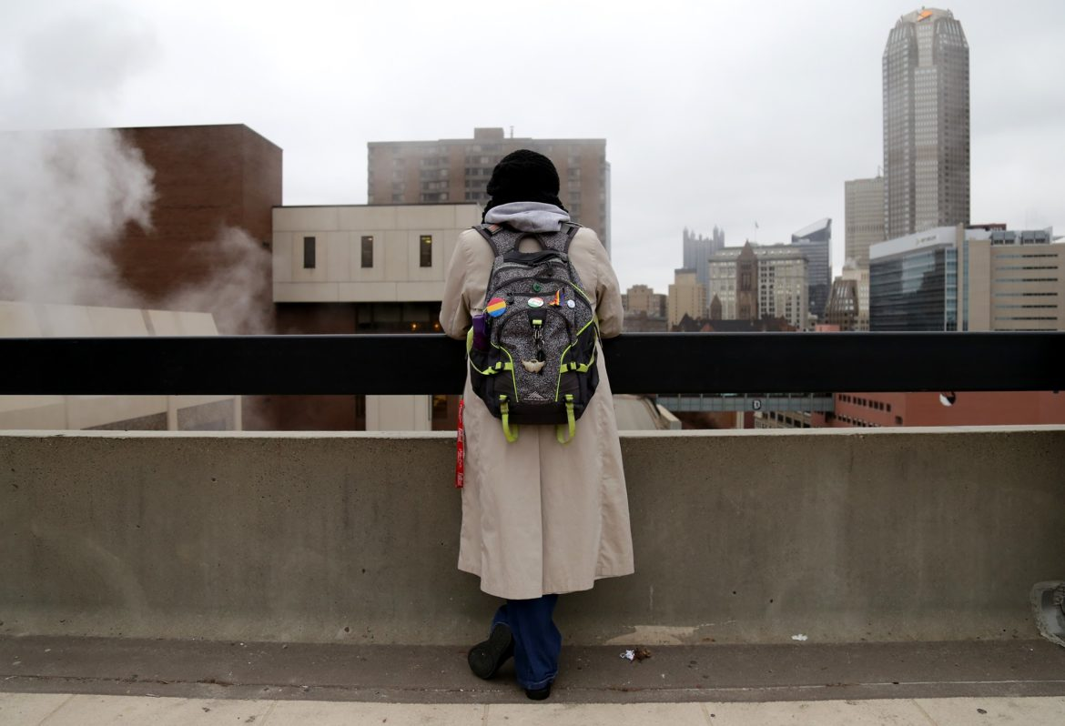 Nicole, who is using her middle name to avoid being identified, posed for a photo on the Duquesne University campus. She is a sophomore at the school, and not even her roommate knows she has struggled with homelessness. (Photo by Guy Wathen/PublicSource)