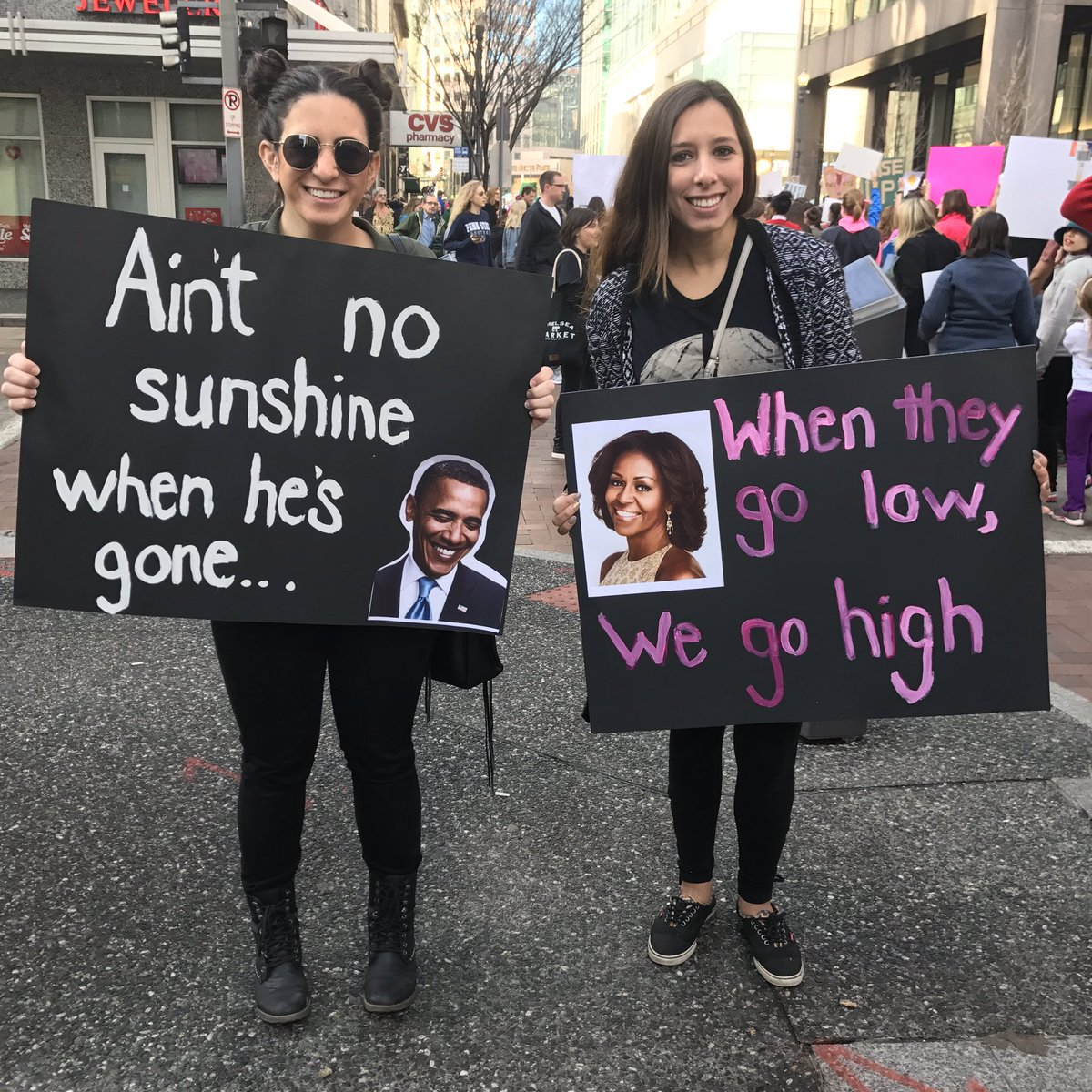 "Courtney McNary, right, teacher at the Pittsburgh Public Schools, ""It's important... to show my students to stand up for what you believe in."" Olivia D'Mato (left) said she marched today because she doesn't believe in what Trump stands for. (Photo by Natasha Khan/PublicSource)"