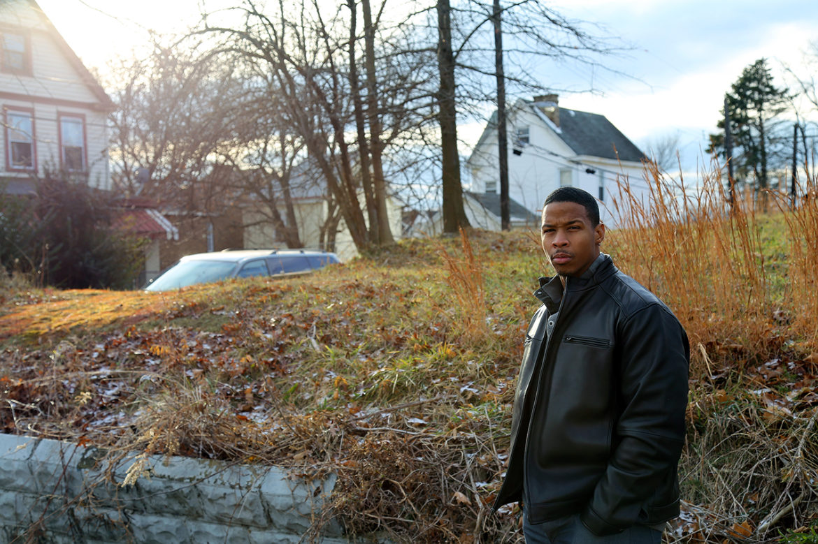 Terrell Thomas, pictured in front of the vacant lot that used to be his family home, lost his brother to gun violence in Beltzhoover in 2001. Sixteen years later, he's troubled by persistent violence on the Hilltop. (Photo by Jeffrey Benzing/PublicSource)