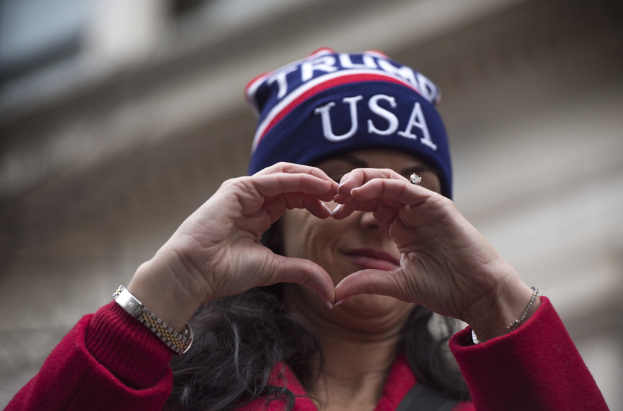 A Trump supporter uses her hands to send a message during the Women's March on Washington in Washington D.C. (Photo by Martha Rial for PublicSource)