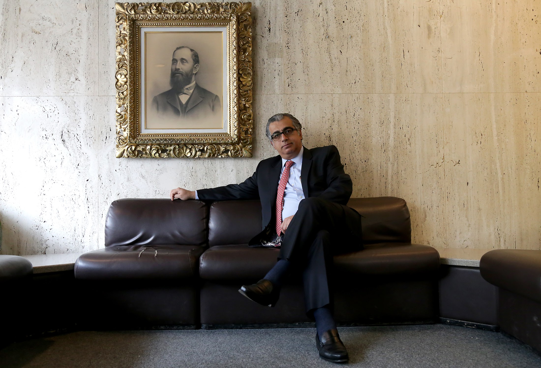 Ali Al-Khafaji, pictured here in Scaife Hall, is a professor of critical care medicine at the University of Pittsburgh and a medical director at UPMC Montefiore. He was born in Britain, raised in Iraq and is a U.S. citizen. His sister was supposed to visit from Iraq recently, but had to cancel because of Trump's executive order. (Photo by Guy Wathen/PublicSource)