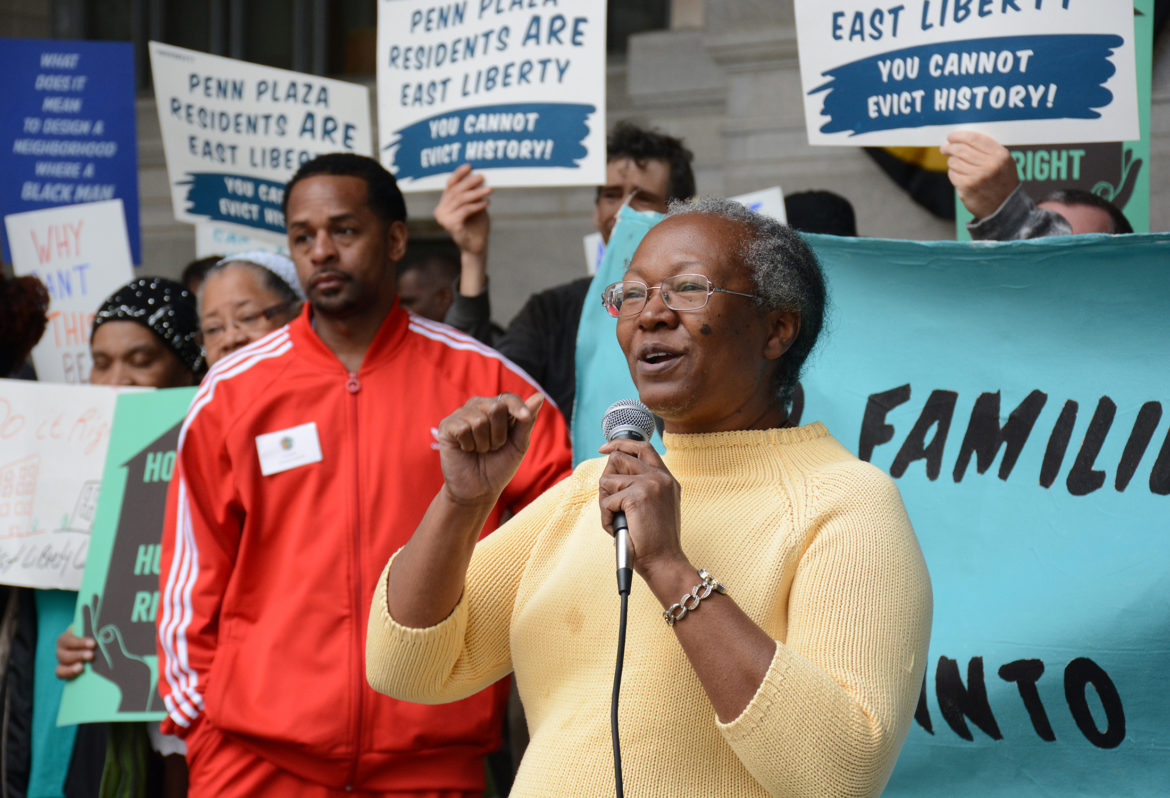 Alethea Sims, 61, speaks outside the City-County Building on Tuesday during a protest against the owners of Penn Plaza, LG Realty. Sims was displaced from her home in East Liberty by development in the early 2000s and has been fighting for affordable housing and against gentrification ever since. (Photo by Stephen Caruso/PublicSource)