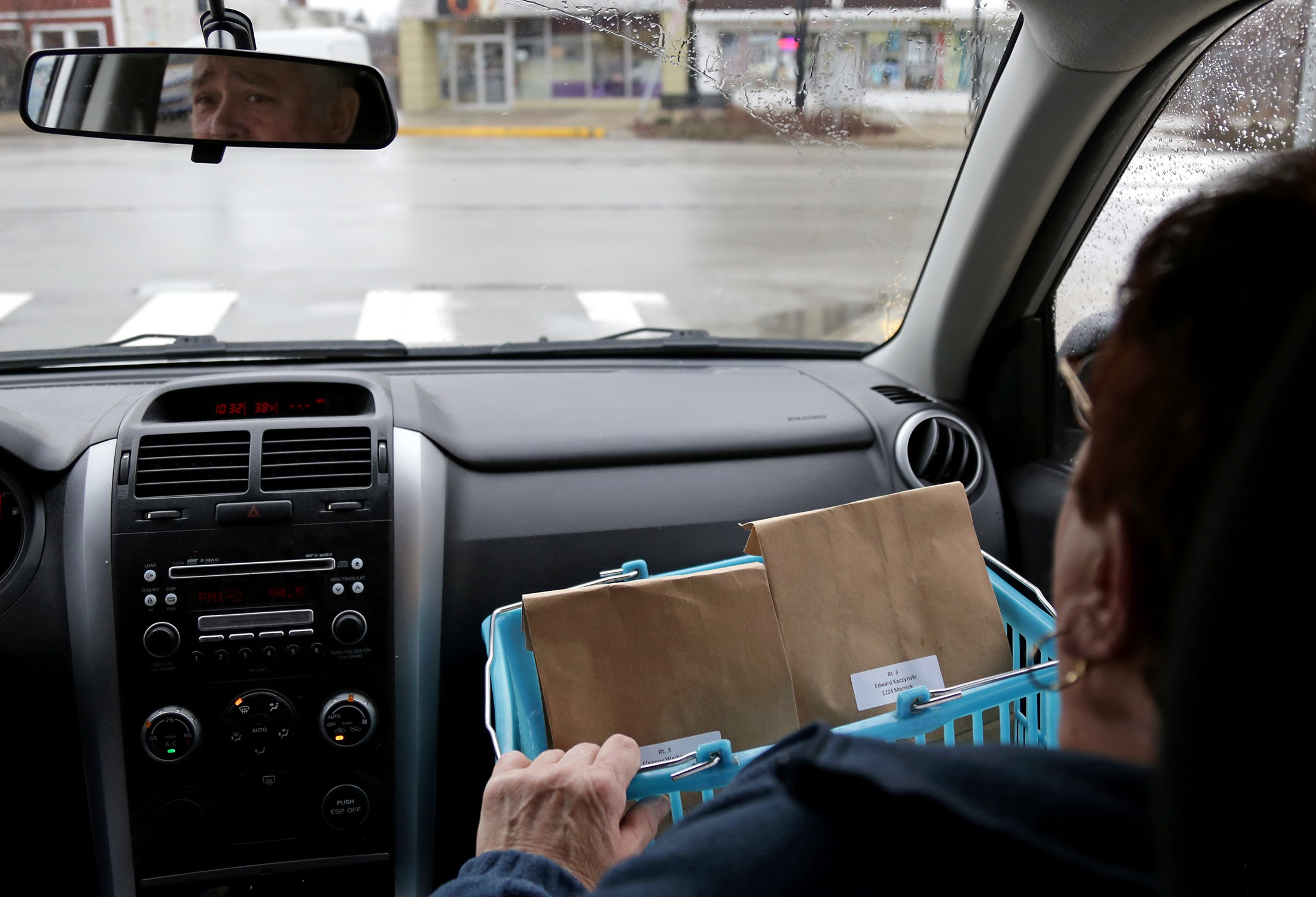 Randy and Roberta Nerone drive through Brookline while volunteering for Meals on Wheels on Tuesday, Jan. 24, 2017. Randy has been volunteering with the organization for about 15 years while his wife, Roberta, has given 20 years of service. They typically deliver meals to six to eight people on their route. (Photo by Guy Wathen/PublicSource)