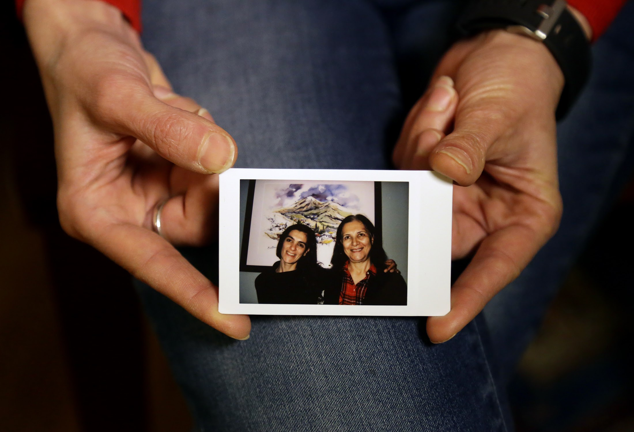 Rosta Farzan's mother, Simin Dehghan (right), is an Iranian citizen and has a green card. She spends about six months a year visiting her daughter, a Pitt professor, in Pittsburgh and volunteering at the Carnegie Museum of Art. But now, if Trump's order stands, her mother will be barred from coming back. (Photo by Guy Wathen/PublicSource)