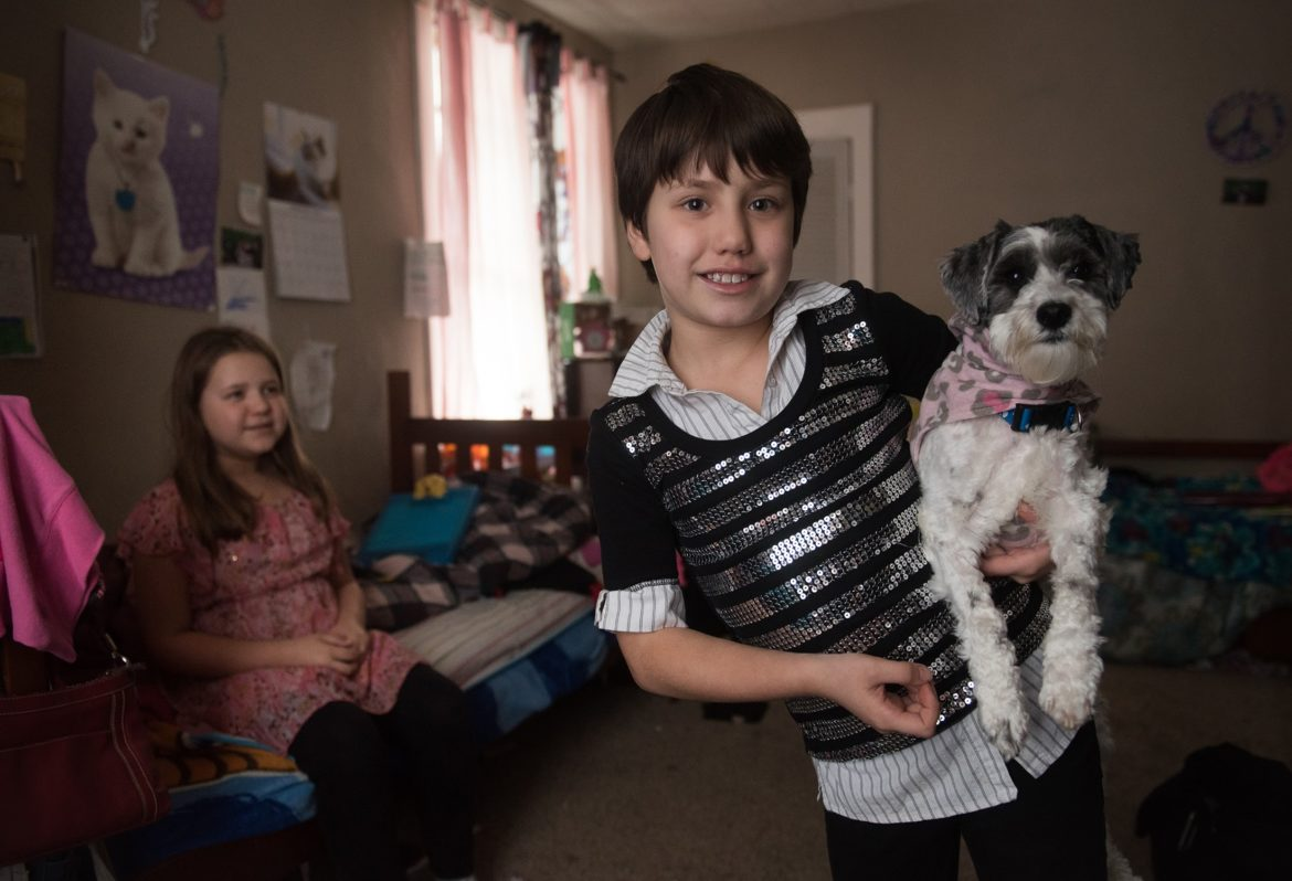 About a year after the incident, the Snyder family got a dog themselves. Here, Sabrina Snyder is holding Dinkie, a Shih-Tzu and Maltese mix. Sabrina, who was attacked by a dog in August 2014, said her fear of dogs has finally subsided. (Photo by Justin Merriman/PublicSource)