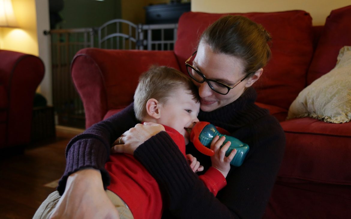 Bridget Urda, 33, hugs her son, Clayton, at their home in Morningside on March 14, 2017. (Photo by Ryan Loew/PublicSource)