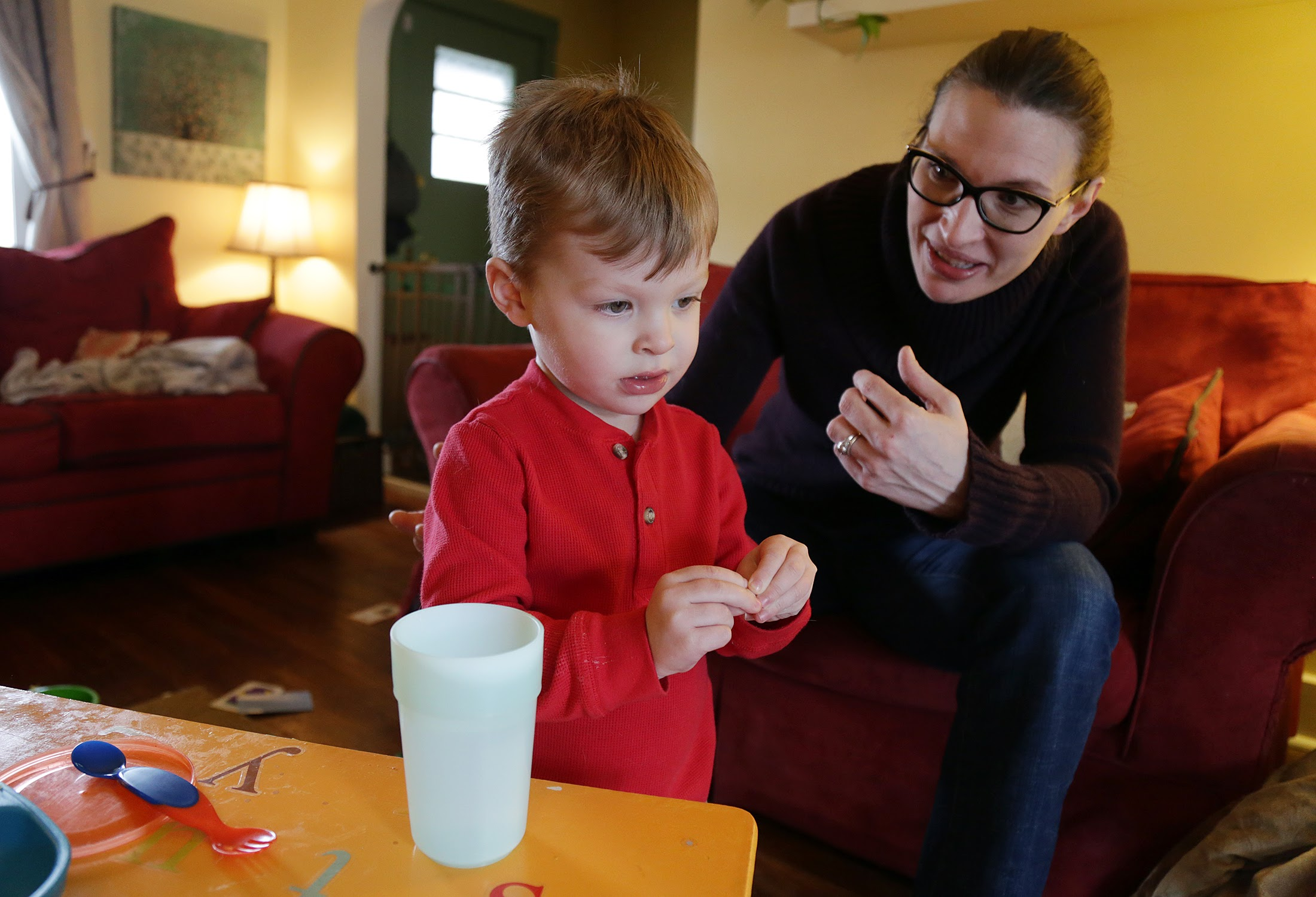 Bridget Urda, 33, spends time with her son Clayton at their home in Morningside. Urda sent her lead testing kit to the Pittsburgh Water and Sewer Authority on Aug. 9, 2016. The test would later show her water contained 16.4 parts per billion of lead — 1.4 ppb above the EPA action limit. (Photo by Ryan Loew/PublicSource)