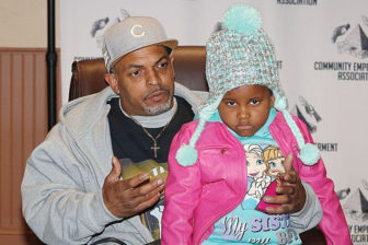 Homewood resident Todd Griffin and his daughter, Makeela, may be forced to leave their HUD-subsidized home. (Photo by J.L. Martello/New Pittsburgh Courier)