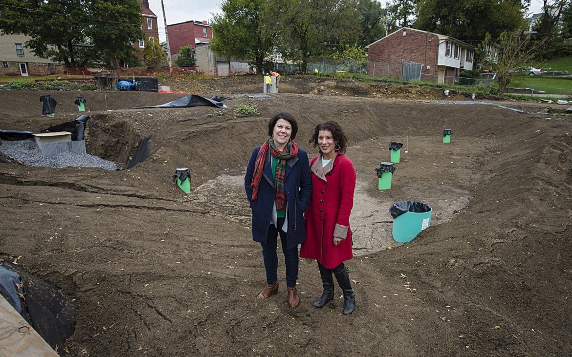 Pittsburgh Water and Sewer Authority's Megan Zeigler (left) and Rebecca Zito pose at the site of a green infrastructure project at Hillcrest Street in the Garfield neighborhood of Pittsburgh. Zeigler is the green infrastructure coordinator at PWSA. (Photo by Teake Zuidema/PublicSource)