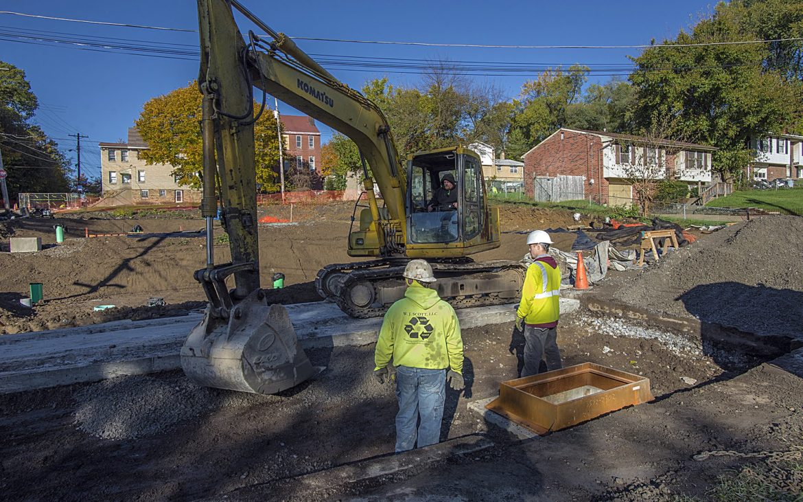 A crew of contractors at work at the Hillcrest Street green infrastructure project, led by the Pittsburgh Water and Sewer Authority. (Photo by Teake Zuidema/PublicSource)