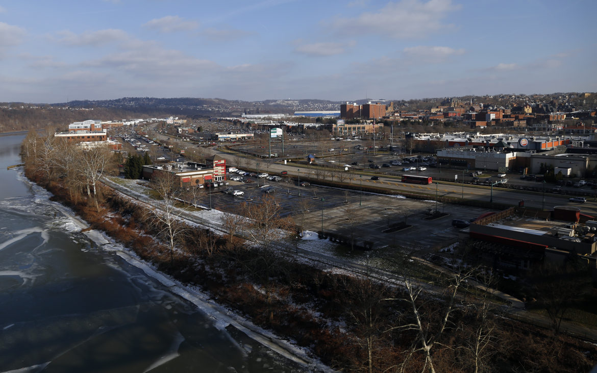 The Waterfront stretches along the Monongahela River across the shorelines of three towns, Munhall, Homestead and West Homestead, and has a cluster of big-box stores, chain restaurants and other businesses. (Photo by Ryan Loew/PublicSource)