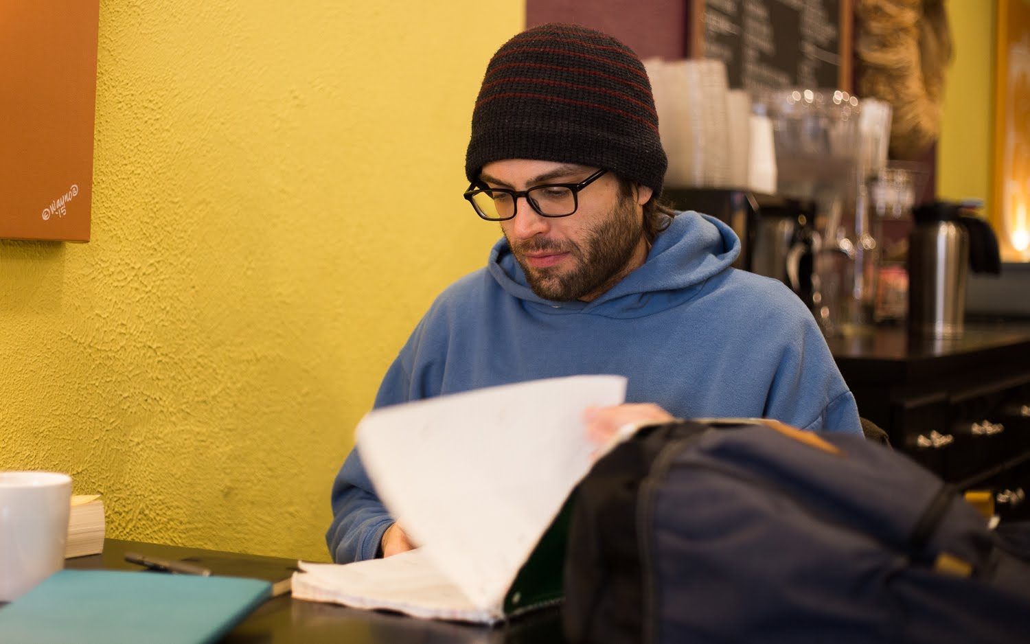 Robb Full, 39, works with a cup of coffee at Uptown Coffee in Mt. Lebanon. (Photo by John Hamilton/PublicSource)