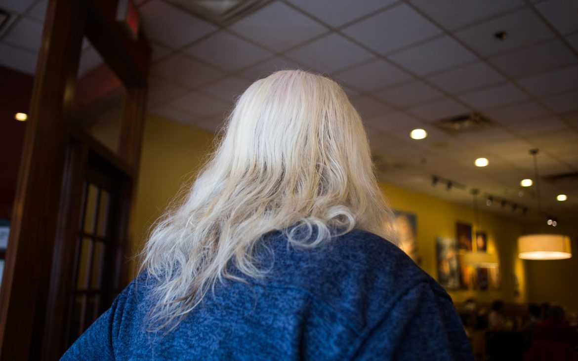 """I'm living my 60's dream right now,"" Tom Scantling said of his hair in a Carnegie Panera Bread. (Photo by John Hamilton/PublicSource)"