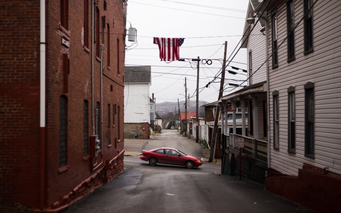 A car travels down South Washington Street in Waynesburg, the largest municipality in Greene county with a population of 4,176. (Photo by John Hamilton/PublicSource)