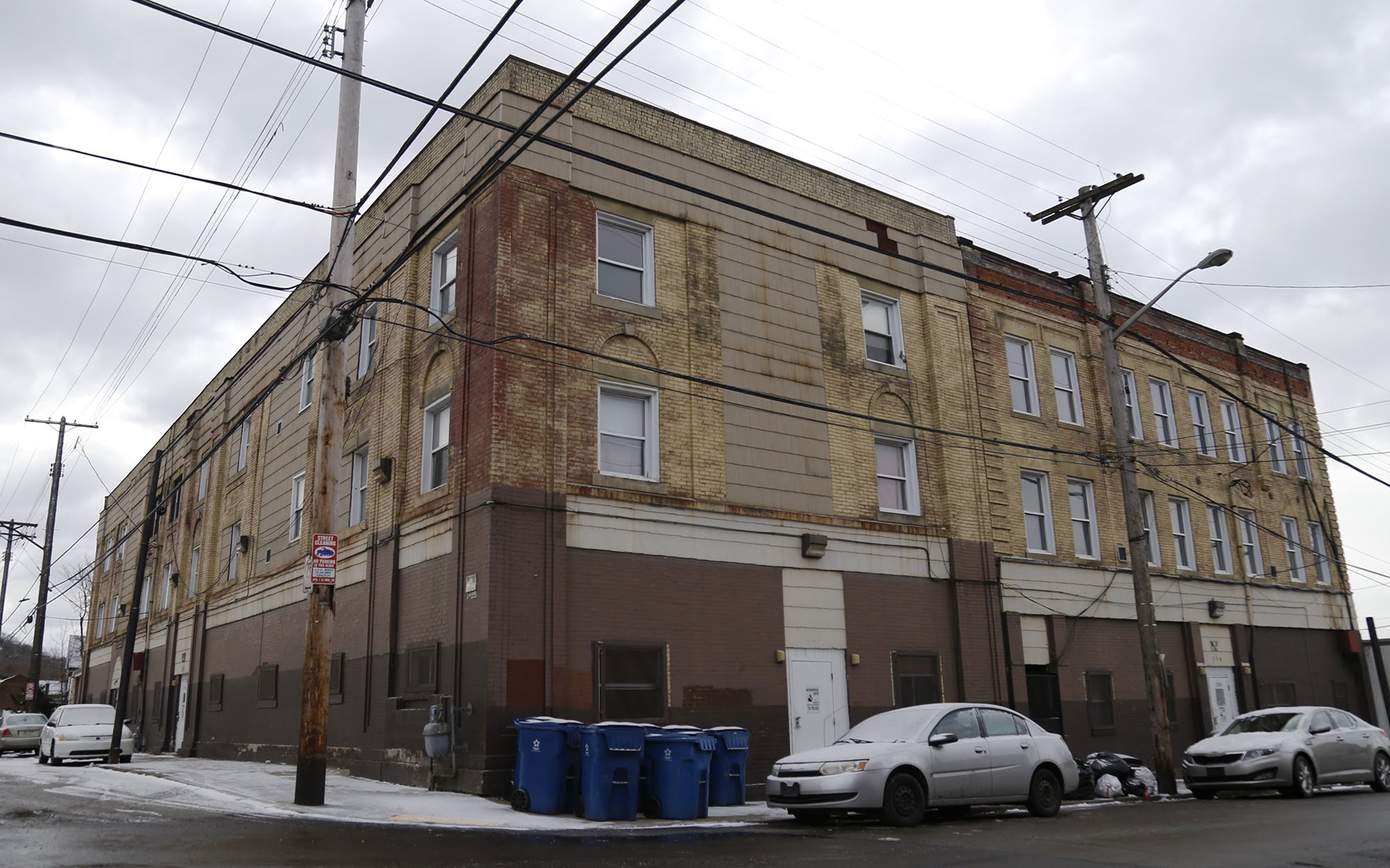 Tyrone Goodwin's apartment building, at the intersection of Tioga Street and Brushton Avenue, is one of the 32 Bethesda-Homewood properties. (Photo by Ryan Loew/PublicSource)