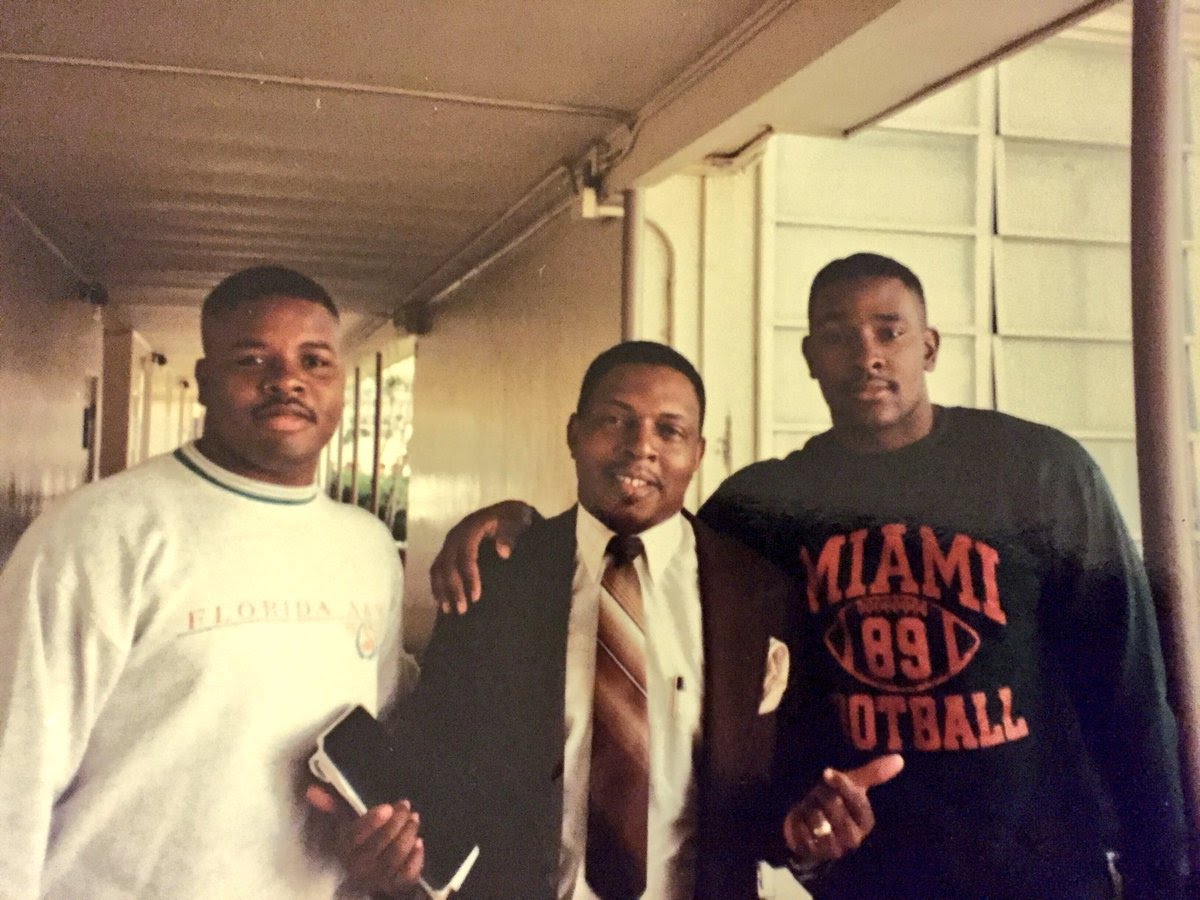 Anthony Hamlet in his sophomore year of high school with one of his former teachers and mentors, the late Edward Harris, center, and, Hamlet's cousin, Jerome Hamlet, left. (Courtesy photo)