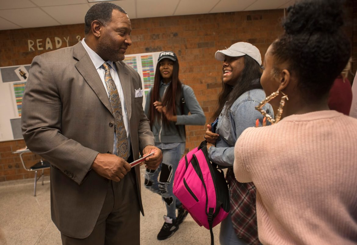 Superintendent Dr Anthony Hamlet is recognized by students Demetress Wright and Savannah Penn during a visit to Brashear High School for instructional review. (Photo by Martha Rial/PublicSource)