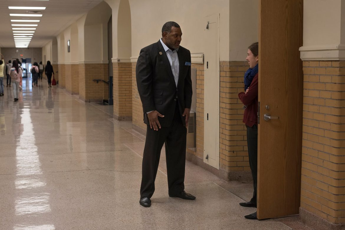 Superintendent Dr Anthony Hamlet stops to speak with French teacher Clemence Darriet (right) during a visit to Westinghouse High School in December. (Photo by Martha Rial/PublicSource)