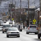 Traffic moves along Second Avenue in Hazelwood. (Photo by Ryan Loew/PublicSource)