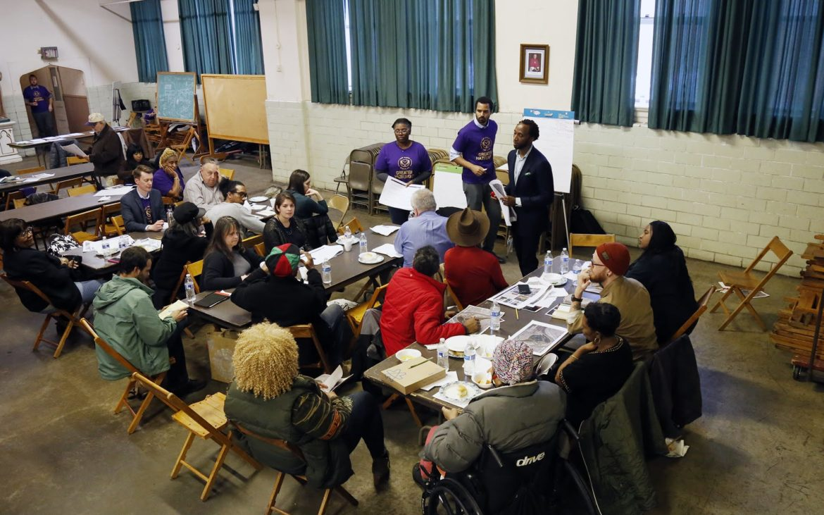 The Community and Economic Development Action Team meets as part of the second large community meeting for the Greater Hazelwood Neighborhood Plan on Feb. 19, 2018 at the Spartan Community Center of Hazelwood. (Photo by Ryan Loew/PublicSource)