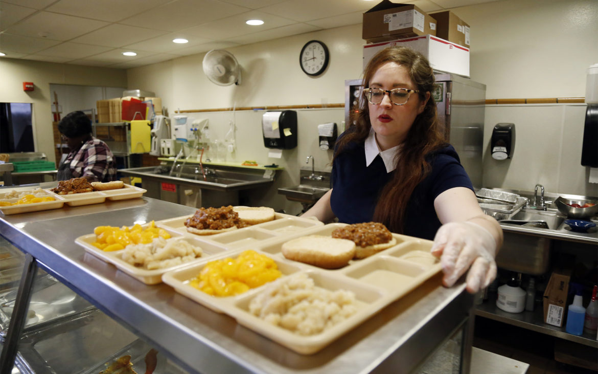 Julianna Bagwell, food service assistant at the Environmental Charter School, prepares lunch on Feb. 6, 2018. (Photo by Ryan Loew/PublicSource)