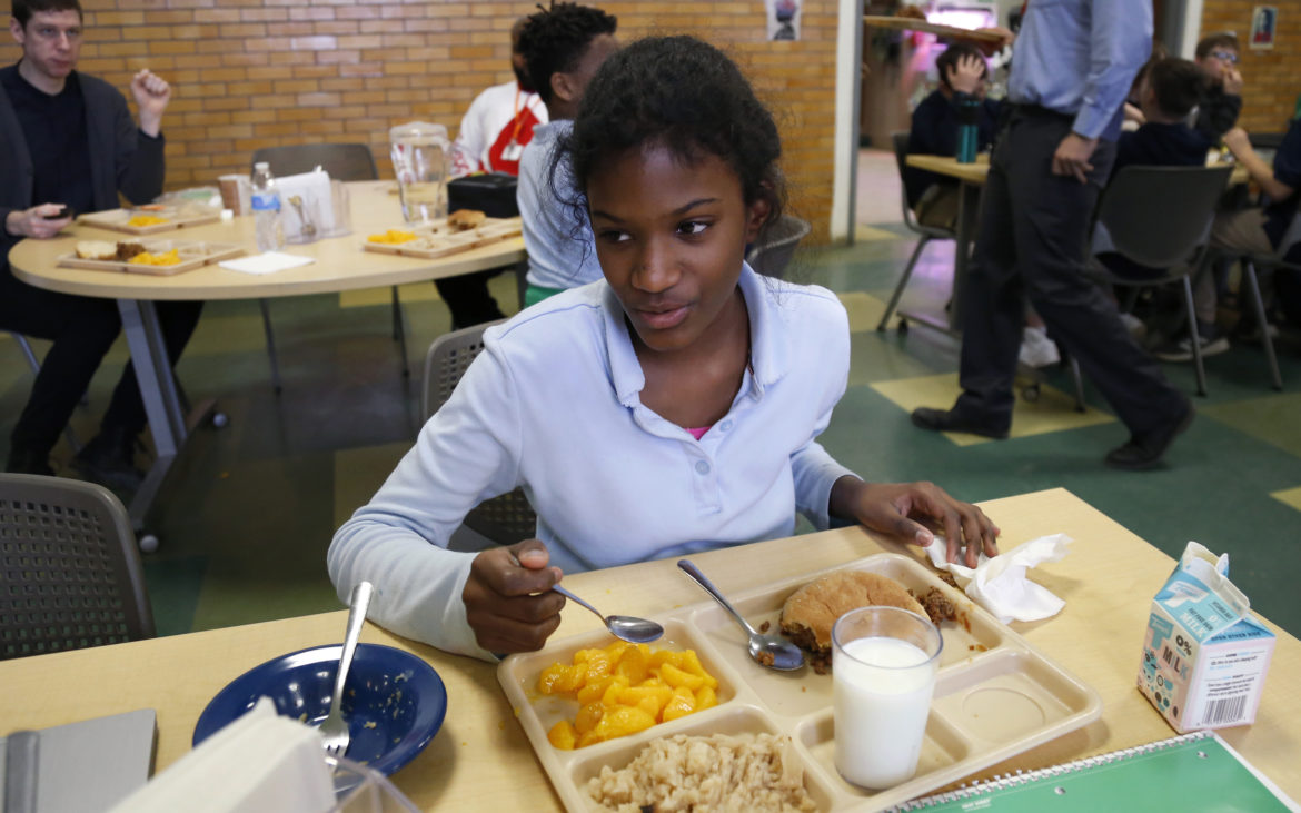 Environmental Charter School sixth grader Ophelia Quashie, 12, eats lunch on Feb. 6, 2018. (Photo by Ryan Loew/PublicSource)